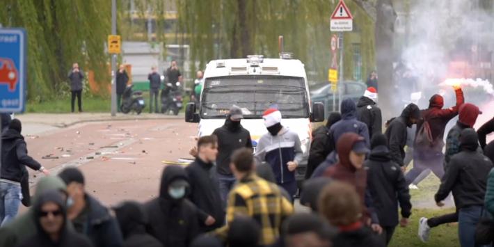 Acht Feyenoord-fans aangehouden, zes ME'ers naar ziekenhuis