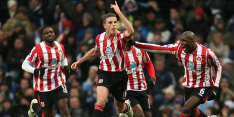 Liverpool en Sunderland rond over Henderson
