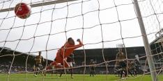 Carroll kopt titelaspiraties Arsenal de prullenbak in